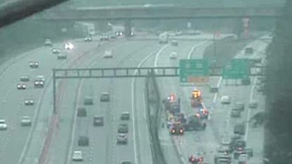 A cluster of emergency vehicles working at wreck site block the two lanes from I-97 southbound to Route 50 East. The 4 p.m. accident kept the road shut down until just after 6:30 p.m. creating a backup on I-97 over six miles long.