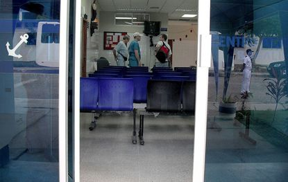 The waiting room of Ecuadent's dental clinic is shown through the doors on the building during the foundation's February mission in Salinas, Ecuador.