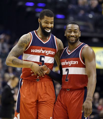 Washington Wizards forward Markieff Morris (5) and guard John Wall (2) celebrate in the final minute of the second half of an NBA basketball game against the Indiana Pacers in Indianapolis, Thursday, Feb. 16, 2017.