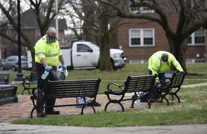 Westminster city workers disinfect benches out of an abundance of caution in Belle Grove Square Park on March 19 after the Westminster Volunteer Fire Department responded to a medical call there that day. Carroll County's fire companies are also taking steps to mitigate the risk of spreading the coronavirus.
