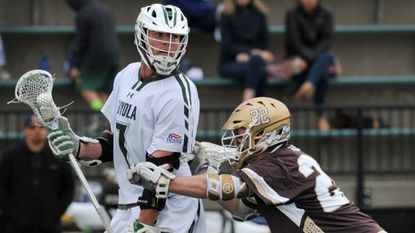 Loyola Maryland's Pat Spencer withstands pressure from Lehigh's Ian Strain near the end of the 2018 Patriot League championship game. He had five goals and two assists in Loyola's season-opening win over Virginia on Saturday.