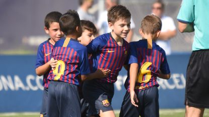 More than 50 children live, study, train and play at FC Barcelona's famed youth academy, La Masia, just outside the city.