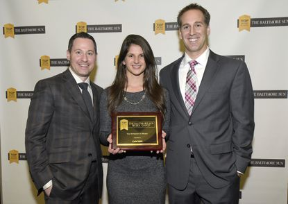From left, Jason Goldsmith, Lindsey DeGuiseppi and Joe Campanella, of CARCHEX, at The Baltimore Sun's Top Workplaces 2015 awards.