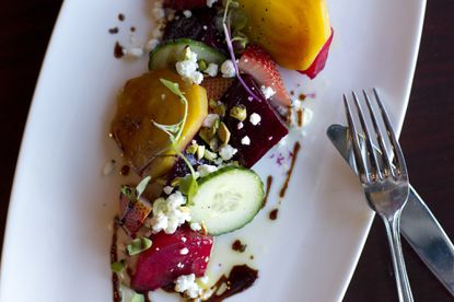 Roasted beets and goat cheese salad with pomegranate molasses and fennel salt prepared by Chef Daniel Chaustit at Lib's Grill in Perry Hall.