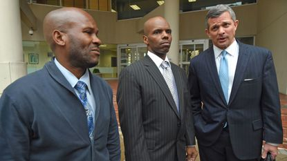 Brent Matthews and Umar Burley, shown here leaving federal court with their attorney Steve Silverman after a judge agreed to vacate their convictions in a case where prosecutors say drugs were planted on them by crooked Baltimore police officers.