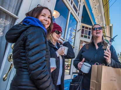 The cocoa was flowing down Main St. Sykesville Saturday afternoon as old friends Jana Fratto, Ellicott City, Michelle Adams and Donna Forman, both of Sykesville enjoy the sunshine and Cocoa Crawl.