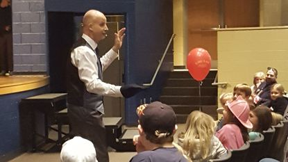 David Thomen of D's Magic entertains the audience during a performance March 10. Thomen's show was held during the annual Hampstead-Manchester Business & Community Expo held at Manchester Valley High School. More than 100 local businesses and organizations were present.
