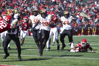 Maryland running back Javon Leake (20) carries the ball into the end zone for a 12-yard touchdown against Rutgers during the third quarter of an NCAA college football game, Saturday Oct. 5, 2019, in Piscataway, N.J.