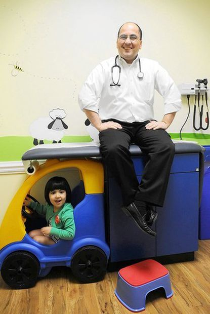 Keyvan Rafei, medical director of Laurel's KinderMender walk-in pediatric center, was at the center's open house March 16 with daughter Lily, 3.