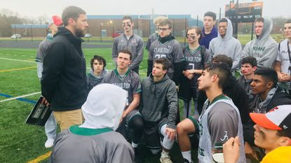 Atholton boys lacrosse coach Alex McCoy talks to his players after defeating Oakland Mills on April 5, 2019.
