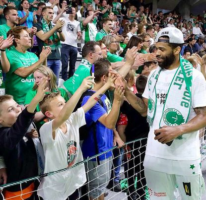 "Former Maryland and St. Frances standout Sean Mosley celebrates with fans of Le Portel after helping team to French ""B"" League title last June. (photo courtesy of Sean Mosley) This is for story that will run in early editions Sunday to hold space for Maryland game."