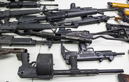 Handguns, rifles, shotguns and assault weapons collected in a Los Angeles Gun Buyback event are displayed during a news conference in Los Angeles. Last month, a federal judge overturned California's three-decade-old ban on assault weapons ruling that it violates the constitutional right to bear arms. (AP Photo/Damian Dovarganes, File)
