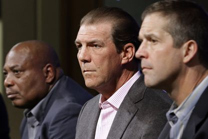 Baltimore Ravens owner Steve Bisciotti, center, listens to a reporter's question as he sits between general manager and executive vice president Ozzie Newsome, left, and coach John Harbaugh, Tuesday, Feb. 24, 2015, in Owings Mills. The team held the news conference to review the 2014 season and discuss the upcoming season.