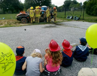 Children and others gathered to watch members of the New Windsor fire company demonstrate an extrication from a wrecked car during a past National Night Out event in New Windsor.