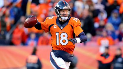 Broncos quarterbackPeyton Manninglooks to pass against the Steelers while scrambling away from pressure Sunday.