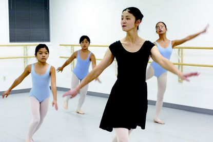 Misako Aoki, center, produced her first online ballet class on March 23 on Zoom.