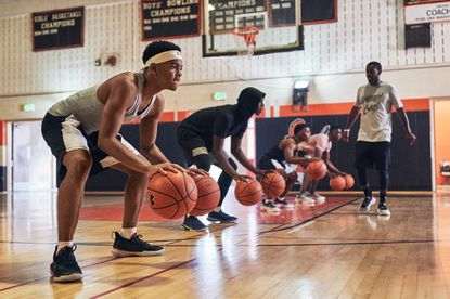 User Upload Caption: The Baltimore City College boys basketball team is being featured in Under Armour's kick-off campaign for its new Curry 7 basketball sneakers. - Original Credit: For The Baltimore Sun