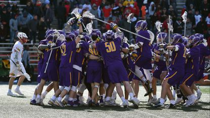 The No. 1 Albany men's lacrosse team celebrates after completing a fourth-quarter comeback to beat No. 2 Maryland, 11-10, at Maryland Stadium on Saturday.