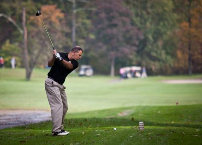 Installation Commander Col. Edward Rothstein drives a ball during the Commanders Cup golf tournament in October at Fort Meade.