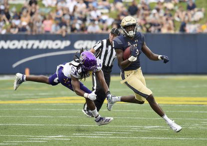 Wide receiver Mychal Cooper and the rest of the Navy offense left East Carolina defenders grasping at air quite often last season in routing East Carolina, 42-10, in Annapolis. (Paul W. Gillespie/The Baltimore Sun via AP)