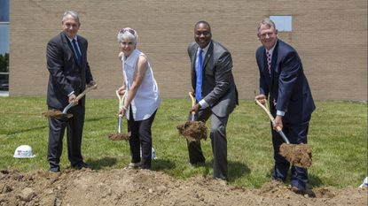 County Executive Calvin Ball, second from right, breaks ground on the new courthouse in Columbia on Monday. With him are, from left, former council members Jon Weinstein and Mary Kay Sigaty and former County Executive Allan Kittleman.