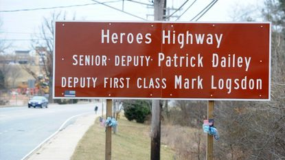 A sign along Rt. 924 near the Boulevard at Box Hill in Abingdon dedicating the stretch as Hereos Highway in memory of slain Harford County Sheriff's Office Senior Deputy Patrick Dailey and Deputy First Class Mark Logsdon.