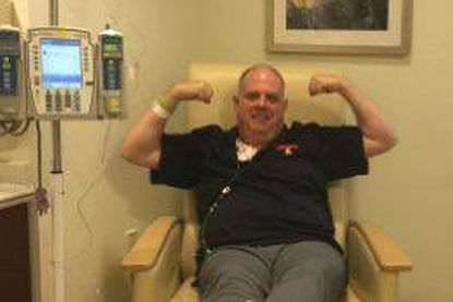 A facebook post shows Gov. Lerry Hogan flexing his biceps in a Baltimore hospital room as he completes his chemotherapy treatment.
