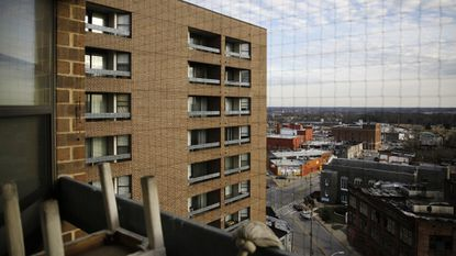 The Rosemont Tower in West Baltimore from a resident's balcony. Health and safety inspectors gave the 200-unit public housing high-rise a failing score of 25 out of a possible 100 in 2017 and then last year a score of 71, according to the housing authority.