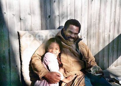 Author Christina Lewis Halpern with her father Reginald F. Lewis in the mid-1980s.