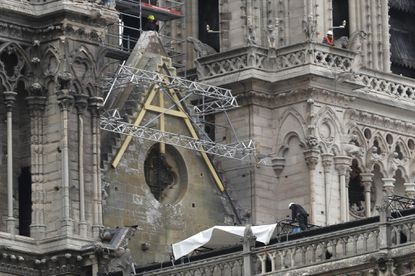 Mountain climbers hired to install tarps to protect gutted Notre Dame Cathedral roof from rain
