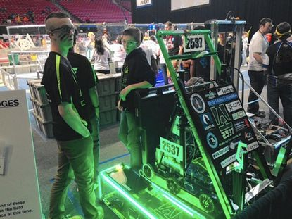 Atholton High School students stand in the queue area before a First Robotics match at the Xfinity Center Friday.