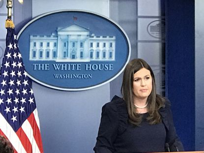 Sarah Huckabee Sanders addresses the media at a White House press briefing.