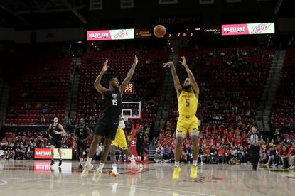 Maryland guard Eric Ayala (5) shoots over Oakland guard Kevin Kangu (15) during the second half of an NCAA college basketball game, Saturday, Nov. 16, 2019, in College Park, Md. Maryland won 80-50. (AP Photo/Julio Cortez)
