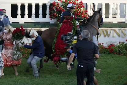 Trainer Bob Baffert is knocked out of the way as jockey John Velazquez tries to control Authentic in the winner's circle after taking the 146th running of the Kentucky Derby at Churchill Downs in Louisville, Ky., on Saturday. (AP Photo/Jeff Roberson)