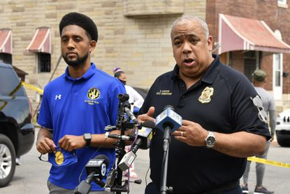 Baltimore Mayor Brandon Scott, left, and Police Commissioner Michael Harrison give a short briefing Sunday about the fatal shooting of a man in the 1800 block of E. Lafayette Ave.
