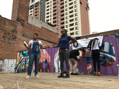 Nearly 50 people gathered Friday at Ynot Lot in Baltimore to remember Bailey Reeves, a transgender woman who was killed on Labor Day in Northeast Baltimore.