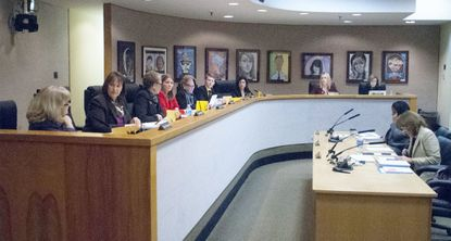 The Howard County Board of Education at a meeting in December 2014.