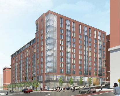 An early conceptual design of a 12-story building with 157 student apartments and 31,500 square feet of commercial space on the lot at the southwest corner of St. Paul and East 33rd streets.