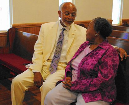 Rev. Douglas Sands talks and laughs with a classmate from high school, Joan Holley, after a church service at White Rock Independent Methodist Episcopal Church, in Sykesville, July 5._- Original Credit: Natalie Eastwood/Staff photo