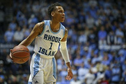 Rhode Island's Fatts Russell (1) during the second half of an NCAA college basketball game against Dayton Wednesday, March 4, 2020, in Kingston, R.I. (AP Photo/Stew Milne)