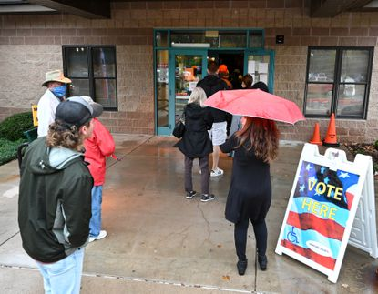 Despite Thursday's wet weather a steady flow of voters came out to the McFaul Activities Center in Bel Air to cast their votes as early voting continues in Harford County.