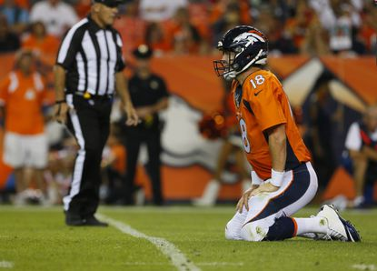 Denver Broncos quarterback Peyton Manning kneels after being hit against the San Francisco 49ers in the preseason.