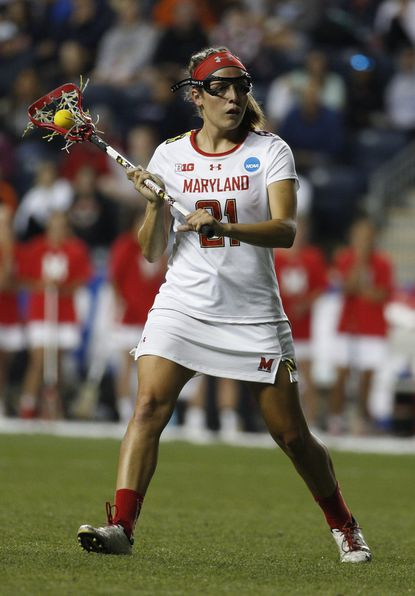 Maryland's midfielder Taylor Cummings in action during the second half of the semifinals in the NCAA Division I women's lacrosse tournament against the Syracuse, Friday, May 22, 2015, in Chester, Pa. Maryland won, 10-8.