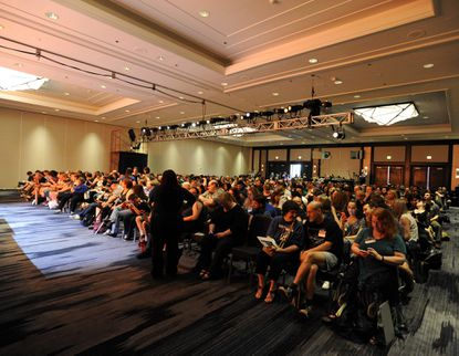 """A Balticon audience waits for """"Game of Thrones"""" author George R. R. Martin to appear on stage. File"""