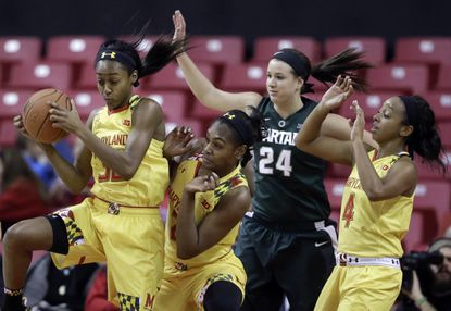 Maryland guard Shatori Walker-Kimbrough, left, grabs a rebound during the second half of a Jan. 22 game against Michigan State last season.