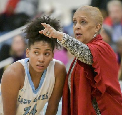 River Hill senior Saniha Jackson, pictured here talking to Hawks coach Teresa Waters in a game earlier in her career, led the Hawks with 26 points in the team's 68-36 win over Centennial on Wednesday, Jan. 15, 2020.