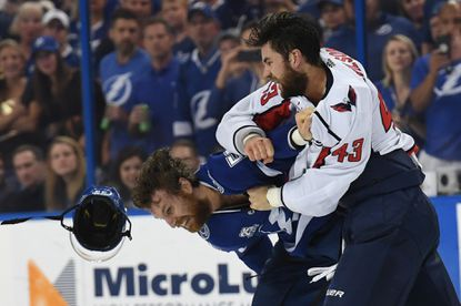 Washington Capitals right wing Tom Wilson punches Tampa Bay Lightning defenseman Braydon Coburn during the first period of Game 7 of the Eastern Conference Finals.