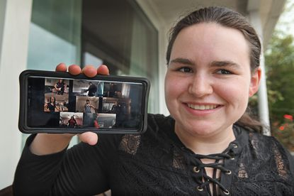 """Dakara Bon, a sophomore at Harford Community College, shows a collage of student actors of the student play """"Mind of a Child"""" performed on """"zoom"""" in Spring during the COVID-19 pandemic shut down. Bon edited the individual performances into a single video using the cell phone she is holding."""