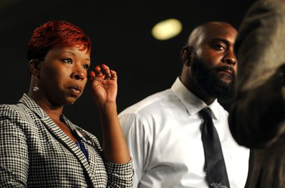Leslie McSpadden, mother of Michael Brown who was killed by police in Missouri, and Michael Brown, Jr., his father, were guests at Empowerment Temple where Pastor Jamal H. Bryant invited the family to speak about fighting peacefully against police brutality.