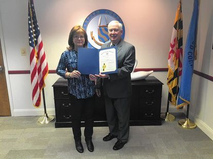 Suzanne Wenzel, left, is honored by Harford County Executive David Craig as the Employee of the Month for October.